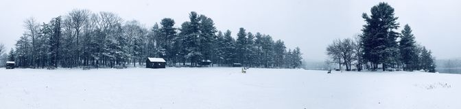 Burr Pond state park panorama winter view. Burr pond state park woods trees covered snow overall view in winter in Torrington Connecticut America stock photography