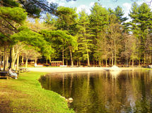 Burr Pond state park spring view. A couple sitting on the bench watching Burr Pond state park beautiful spring views in Torrington Connecticut Stock Images