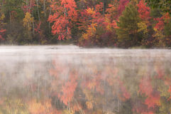 Burr Pond State Park Torrington Connecticut. Burr Pond state park in Torrington, Connecticut during the colorful Autumn season as mist hovers above the lake Royalty Free Stock Images