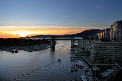 Burrard Bridge. Sunsets behind the Burrard Bridge and The Civic Marina. Vancouver, BC, Canada Stock Photography