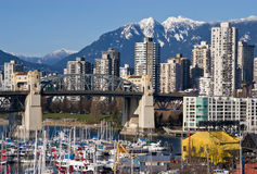 Burrard Bridge. And Downtown Vancouver in sunny winter day stock photos