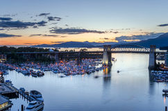 Burrard Bridge and Granville Island Harbour in Downtown Vancouver at Dusk Royalty Free Stock Images