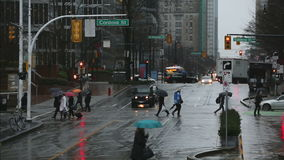 Burrard Street Rain, Vancouver. Busy downtown Burrard Street street during a rain storm. Vancouver, British Columbia, Canada stock video footage