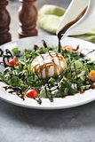 Burrata and arugula salad. With balsamic vinegar glaze pouring over stock photos