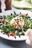 Burrata and arugula salad. With balsamic vinegar royalty free stock images