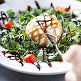 Burrata and arugula salad. With balsamic vinegar stock photography