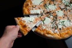 Burrata Caprese. Burrata Mozzarella Caprese accompanied by olives, prosciutto, and arugula Stock Photos