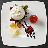Burrata cheese above view. Burrata cheese with gazpacho sauce and tomatoes above view royalty free stock photo