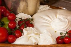 Burrata cheese. With cherry tomatoes basil royalty free stock image
