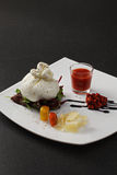 Burrata cheese with gazpacho sauce Royalty Free Stock Image