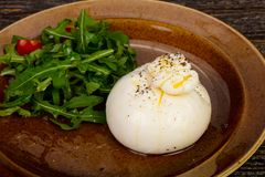 Burrata cheese with oil. And ruccola stock photos