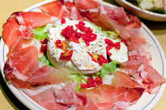 Burrata with parma prosciutto crudo Royalty Free Stock Photo
