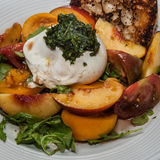 Burrata Salad. Delicious fresh burrata, peach and tomato salad royalty free stock image