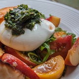 Burrata Salad. Delicious fresh burrata, peach and tomato salad Royalty Free Stock Photos