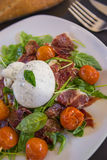 Burrata salad. Salad with tomatoes, ruccola, Burrata and jamon iberico Stock Photo