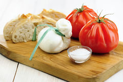 Burrata (sort of very fresh mozzarella cheese), tomato and bread Royalty Free Stock Photography