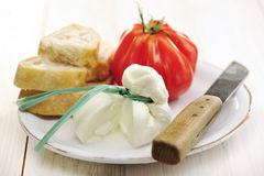 Burrata (sort of very fresh mozzarella cheese), tomato and bread Stock Image