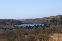 Burrator Lake in winter. Burrator reservoir lake located in Dartmoor National Park,Devon UK in winter on a bright sunny day royalty free stock images