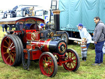 The 'Burrell' miniature road locomotive. Astonished spectators admiring the Burrell miniature road locomotive at the Moorgreen country show, Watnall Stock Images
