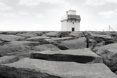 Burren Lighthouse On Rocks Stock Image