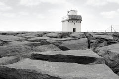 Burren lighthouse on rocks. Lighthouse on rocky landscape of the burren in county clare ireland Stock Image