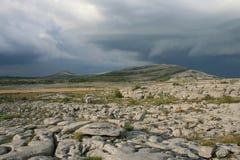 Burren thunderstorm. Thunderstorm building over mountain in the Burren barren rocky desert landscape in county Clare, Ireland Stock Photo