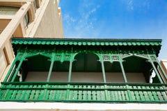Burriana facades in Castellon of Spain. Green balconade stock photo