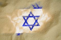 Burried israel flag. Israel flag buried in sand, conflict theme royalty free stock photo
