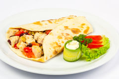 Burrito with beans and chicken. With fresh  cucumber and tomato Stock Photo