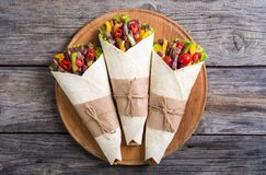 Burrito with beef. Salad , tomato, peppers and haricot . Food background Royalty Free Stock Photos