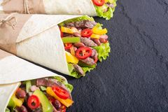 Burrito with beef. Salad , tomato,  peppers and haricot . Food background Royalty Free Stock Images