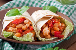 Burrito with chicken, beans and tomatoes Stock Photo