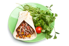 Burrito and coriander. Wrapped tortilla stuffed with beef  chili and coriander on a white background Stock Photos