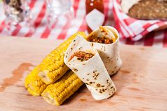 Burrito with corn on wooden board Royalty Free Stock Images