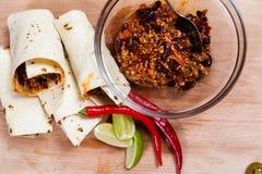 Burrito en el tablero de madera Imagen de archivo