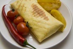 Burrito with fried potato on white Stock Photography