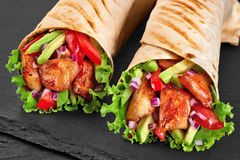 Burrito with grilled chicken and vegetables Stock Image
