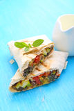 Burrito with grilled vegetables. And sauce with cheese royalty free stock photography