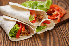 Burrito with meat and ingredients Royalty Free Stock Photos