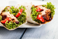 Burrito. Tortilla with meat and beans Stock Photo