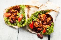 Burrito. Tortilla met vlees en bonen royalty-vrije stock afbeelding