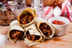 Burrito on wooden board Royalty Free Stock Image