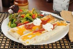 Burritos with cheese and salsa Stock Photos