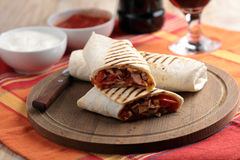 Burritos on a cutting board Royalty Free Stock Photography
