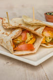 Burritos filled with chicken, peppers, rice and tomato Royalty Free Stock Photo