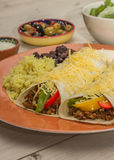 Burritos filled with ground beef and peppers Stock Image