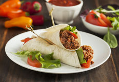 Burritos filled with meat and vegetables Royalty Free Stock Image
