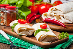 Burritos filled wiht minced meat, bean and vegetables. Stock Photos