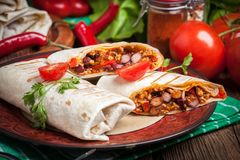Burritos filled wiht minced meat, bean and vegetables. Stock Images