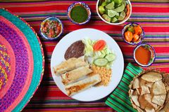 Burritos mexican rolled food rice salad. And frijoles Mexico food Stock Photos